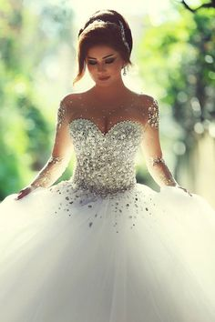Sweetheart ball gown wedding dress,princess wedding dress  Processing time: 15-35 business days  Shipping Time: 3-5 business days  Fabric:tulle  Hemline/Train:floor length   Back Detail:zipper  Sleeve Length:Long Sleeves Embellishments:beading  Shown Color: Refer to image Built-I