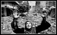 This was a photo taken during the Lebanon War. The women in the picture was said to be praying for peace.