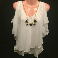 Sheer Blouse NWOT White sheer blouse with a white tank top underneath.  Has a necklace that goes with it also.  Shoulders have slit holes to show off your shoulders. Very nice top. Size 1X could fit LG Three Bird Nest Tops Blouses