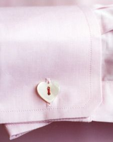 Let him wear your heart on his sleeve with a set of symbolic cuff links, fashioned from mother-of-pearl buttons and silk beading cord.