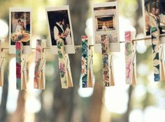 Polaroids clipped with floral clothes pins makes for whimsical & romantic DIY wedding decor. like this even better than the glittered clothes pins. Wedding Table, Rustic Wedding, Wedding Reception, Wedding Seating, Woodland Wedding, Wedding Card, Diy Wedding Decorations, Reception Decorations, Reception Ideas