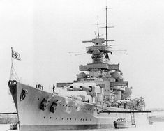Battleship Gneisenau on trials after the 1939 refit which gave her the raked 'Atlantic' bow shown prominently here, and also a funnel cap.  She operated to considerable effect with sister Scharnhorst till February 1942, when she was crippled by RAF bombing whilst in dry dock to repair mine damage sustained in the famous 'Channel Dash' earlier that month.  She is not combat loaded - note from the water line how high she is riding!
