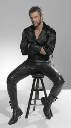 Man in black leather pants and satin shirt