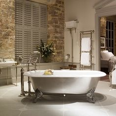 A large double ended cast iron bath tub featuring a wide roll top and traditional ball and claw feet. A classic luxury bath tub inspired by traditional English style. Classic Bathroom, Modern Bathroom, Bathroom Ideas, Serene Bathroom, Bathtub Ideas, Bathroom Designs, Small Bathroom, Country Style Bathrooms, Cast Iron Bathtub