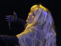 a stunning photo of Stevie onstage   ~ ☆♥❤♥☆ ~   wearing her Gold Dust Woman shawl, and looking so serene, so beautiful, a mature beauty ~ this photo was taken during her  '24 Karat Gold' US 2016 tour