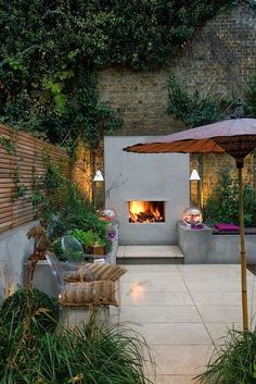 Small town garden design in central London with strong architectural lines and rich planting, dramatic garden lighting and an outdoor fireplace. Small Garden Design, Small Space Gardening, Garden Spaces, Small Gardens, Outdoor Gardens, Urban Gardening, Organic Gardening, Outdoor Rooms, Outdoor Living