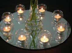Simple decor using mirror plates and tea lights.