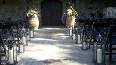 V. Sattui wedding; wine barrel flowers; winery wedding flowers; Petal Town Flowers; wine barrel flowers purple and white; Wedding aisle lanterns
