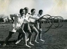 Students exercise with hoola hoops, Newcastle Teachers' College, NSW, Australia - 1955