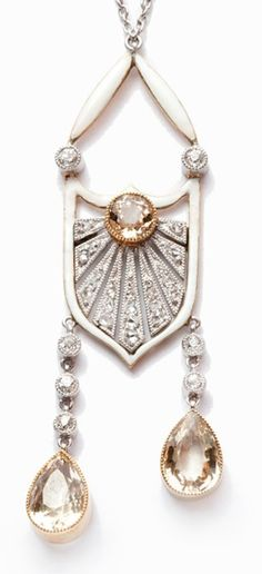 An Art Deco platinum, gold, enamel, topaz and diamond pendant, USA, circa 1920…