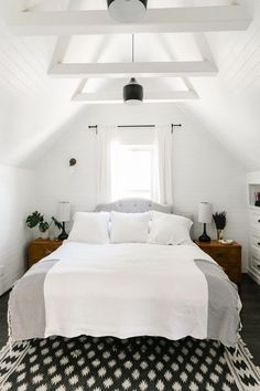 Bright white bedroom with graphic black and gray