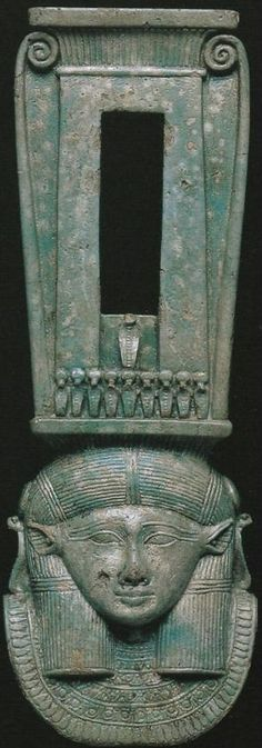 Faience 'naos'-type sistrum decorated with the human-  bovine face of Hathor. 26th Dynasty. British Museum.