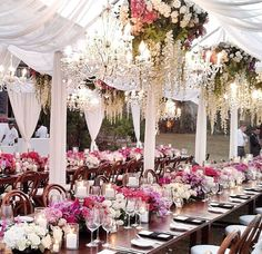 Tented wedding reception with floral chandeliers