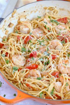 Garlic Shrimp and Tomato Spaghetti is an easy to whip up pasta dinner and a delicious weeknight meal that takes just minutes to prepare. It's sure to be a new favorite!