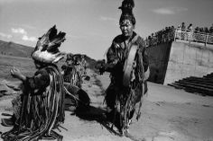 Siberia, Russia, Republic of Tuva. Kyzyl. 2001.  By the river Yenisei, shaman ZOE cleanses other shamans of evil spirits by drumming on her dungur.