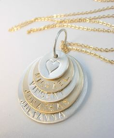 Our Family Stacked Necklace features five discs, in 14k gold fill and sterling silver, personalized with your choice of names. James Michelle