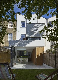 Clever Family Home Makeover in London by Neil Dusheiko Architects - https://freshome.com/2014/01/08/clever-family-home-makeover-london-neil-dusheiko-architects/