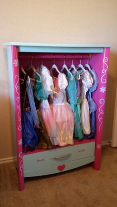 Frozen themed Dress up Dresser! Use an old dresser, take out all drawers except the last, put in a shelf, and paint. I combined Elsa blue with Anna pink!