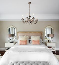 Master Bedroom with mirror backed lamps and faux fur on a pillow .  #Bedroom #MasterBedroom #MasterbedroomDecor