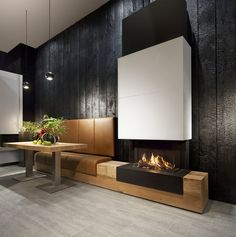 Charred wood walls - Zwarthout deliverd the shou-sugi-ban for Kal-Fire. an interior use.