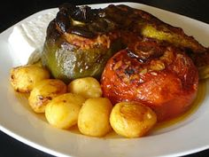 Greek Stuffed Vegetables--Authentic Greek Recipes (Gemista)--I'm not a fan of eggplant & zucchini, so I might sub some pork,lamb, etc. for that in the stuffing.