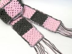 Can be found here: https://www.etsy.com/listing/167720125/crochet-granny-square-scarf-pink-and