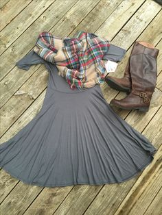 LuLaRoe Nicole dress paired with a plaid scarf and tall riding boots... Perfect for fall! Flat lays by Devin Leigh. #lularoewithdevinleigh #devinsleggings