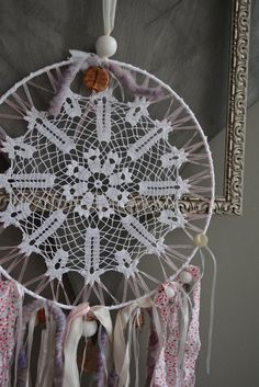 A vintage lace doily dream catcher in soft purple pink by SierGoed, €29.95