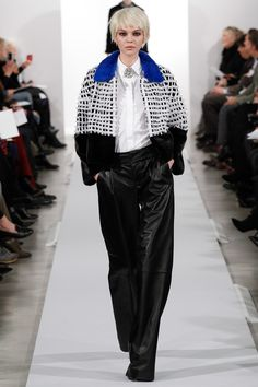 Oscar de la Renta Fall 2014 RTW. #OscardelaRenta #Fall2014 #NYFW blocked mixed texture outerwear. pop of blue. white collared button down with brooch at neck. black leather wide leg trousers.