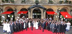 The employees of Hotel Plaza Athenee at the entrance of the hotel