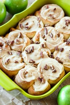Apple cinnamon rolls topped with pecans