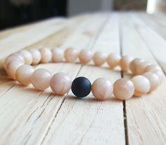 Check out this item in my Etsy shop https://www.etsy.com/listing/455527312/8mm-sunstone-bracelet-matte-black-onyx