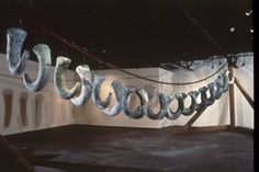 Necklace 19'x45'x21', Saggar-fired clay, chain, wood. [Installed 1991 Nevada Museum of Art, Reno]