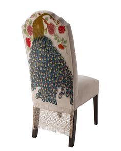 Not my typical style when it comes to furniture, but I love the design on the back of this chair.