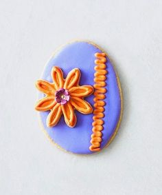 It's easy to upgrade your usual sugar cookie recipe for an ornate Easter treat by whipping up these citrus sugar cookie eggs. Try frosting the cookies with royal icing in pastel hues perfect for spring. Decorate with edible flowers, candy jewels, gold leaf flakes, and even glitter. #eastercookies #eastercookieideas #decoratedcookies #easterfood #dessert #bhg