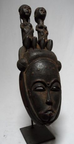 African Baule portrait mask with seated figures (via Wild Bush Gallery)