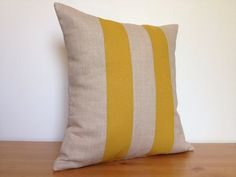 Linen pillow cover with mustard yellow stripes. Striped by HomeInc, $62.00