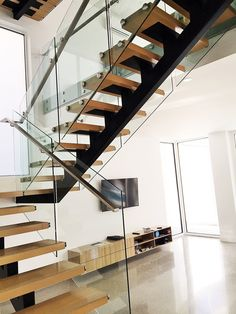 At Toughn Glass, we offer frameless glass balustrade in Melbou rne for many purposes and they can be customized as per the clients need as well. What are you waiting for? Contact us today! Frameless Glass Balustrade, Melbourne House, Glass Door, Stairs, Gallery, Arch, Waiting, Home Decor, Projects
