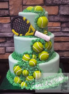 This cake is iced with a light green fondant, decorated with chocolate tennis balls, grass and a tennis racket. All three tiers are made with Oreo filling.