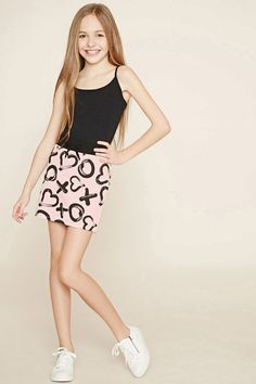 Forever 21 Girls - A French terry knit skirt featuring a contrast elasticized waist, a ribbon accent on the front, and allover X and O graphics with hearts replacing the O's.