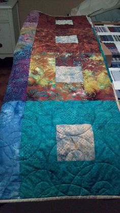 batik free-form quilts | Crazy Rosie Rounds | The Quilt Store, Inc ... : quilt shop names - Adamdwight.com