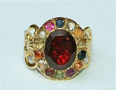 Georgian Planetary Ring, circa 1820.The stones symbolize the qualities of the different planets, reflecting the interest in astrology and planetary influences at the time, when certain gems were perceived to have positive astrological effects.