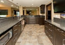 Custom basement wet bar with dark cabinets and granite | Homes by DePhillips Construction