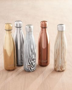 S'well Water Bottles (keeps cold drinks cold up to 24hrs and hot drinks hot for up to 12hrs; may get monogrammed)