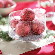 One of our favourite ways to use ornaments is to fill a clear bowl with ornaments to create a beautiful centrepiece for a table. (black and white) Holiday Decorating, Decorating Ideas, Decor Ideas, Wedding Decorations, Christmas Decorations, Wedding Ideas, Clear Glass Vases, Table Centers, Centre Pieces