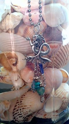 wow, I've seen and not cared for this particular mermaid charm, but how they've used it here is really good.