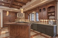 At just over 7000 sq feet a well-designed floor plan and open kitchen offers wonderful flow and easy entertaining. #silverleaf #luxury #scottsdale #realestate #kitchen #interior