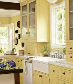 Love this yellow kitchen ~ the farmer's sink & the faucet are the cherries on top ♥