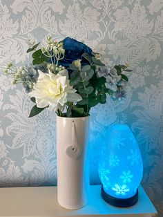 I seen these artifircial flowers in  @therange today and just had to have them!! They are so pretty!! There is #eucalyptus #hydrangea and a blue #rose The vase is from @dunelmuk and the diffuser is from @scentsy ... It has a lifetime guarante!!!  #artificialflowers #home #flowers #vase #homedecor #blue #pretty #roses #premiumdiffuser #relaxingtime #scentsydiffuser #scentsyconsultant #scentsylife #scentsyaddict #relaxwithscentsy #homefragrance #lovewhatyoudo #dowhatyoulove