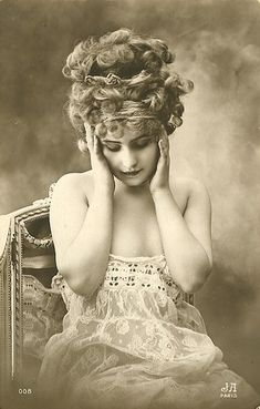 vintage beauty (you gotta wonder...what's hiding in that hair?)  It must be giving her a headache.